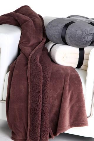 Manta para sofá de color marrón