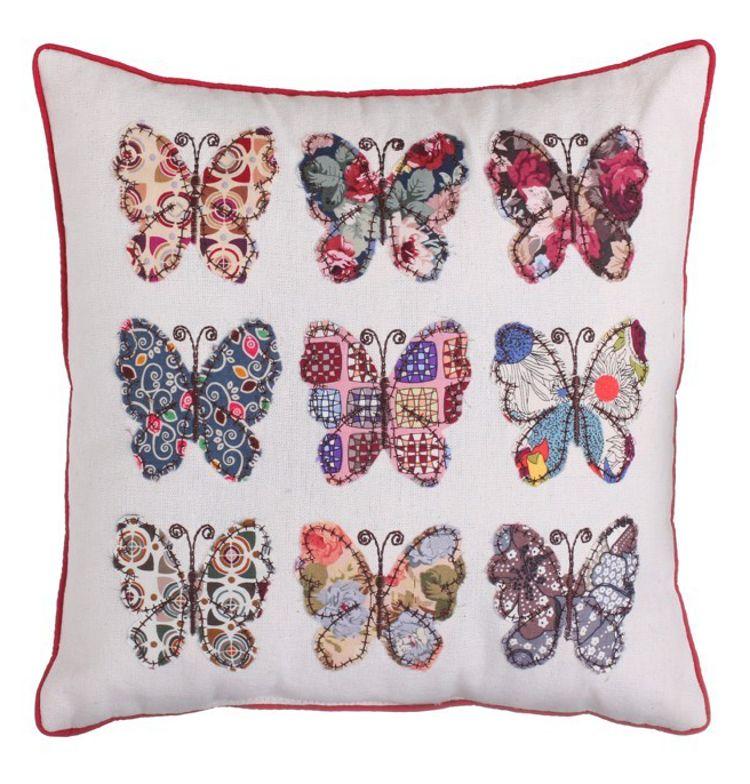 Cojín patchwork con mariposas